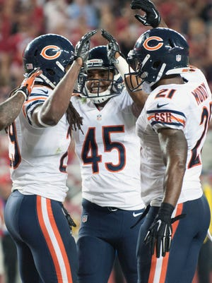 Danny McCray (29), Brock Vereen (45) and Ryan Mundy (21) celebrate a fourth-quarter takeaway in the Bears' win over the 49ers.