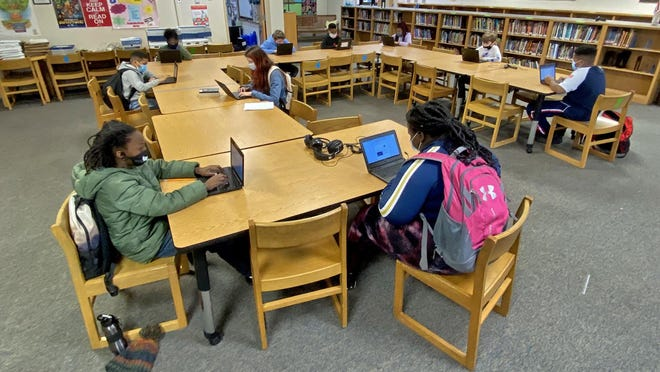 Students spend time in study hall at Shelby Intermediate School on Friday. Study hall time is provided to give students a chance to catch up on virtual learning.