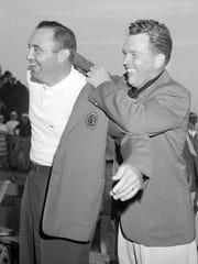 Doug Ford, left, gets assistance from Jack Burke Jr.,