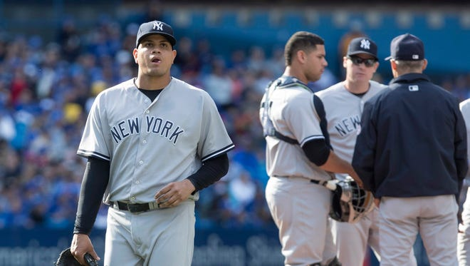 New York Yankees pitcher Dellin Betances comes out of the game in the ninth inning of a baseball game against the Toronto Blue Jays in Toronto, Sunday Sept. 25, 2016.