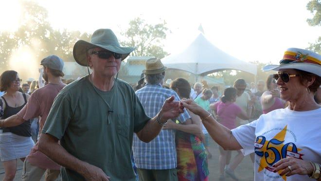 Diana Leger and Ron Bonaventure dance to the band Courtboullion Sunday at Festivals Acadiens et Creoles.