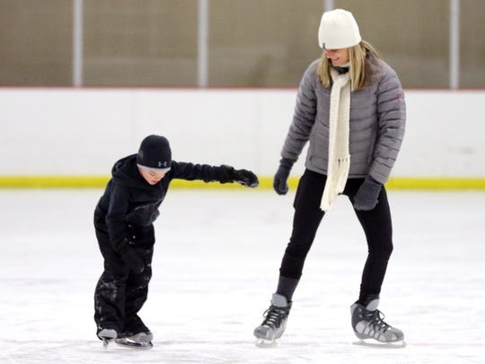 Back in Wisconsin for the holidays, Emmitt Allen, 6, of North Carolina tries his first time on ice with his mother Jamie Allen at the Naga-Waukee Ice Arena in December 2017.