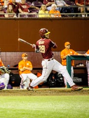 Florida State junior Dylan Busby (28) fouls off a ball during the Seminoles 12-10 loss to Clemson.