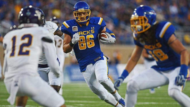 SDSU's Dallas Goedert (86) carries the ball in for a touchdown during a game against Western Illinois Saturday, Oct. 1, 2016, at Dana J. Dykhouse Stadium on the South Dakota State University campus in Brookings, S.D.