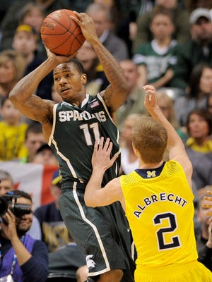 Former Michigan State basketball player Keith Appling faces weapon and drug charges.