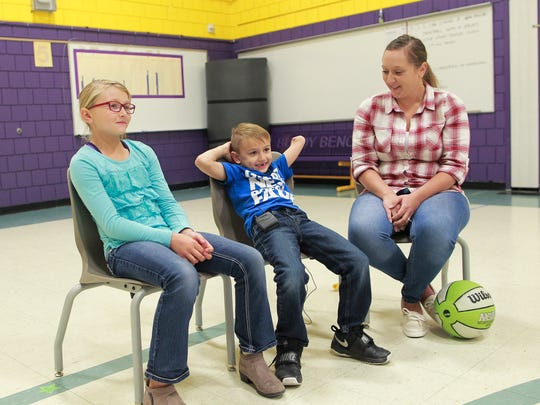 Jayce Crowder, 6, sits with his sister, Allyssa, 10, and his mom, Cortney Lewis, as they talk about meeting Trashaun Willis at Pleasant Hill Elementary in Pleasant Hill on Friday, Oct. 27, 2017.