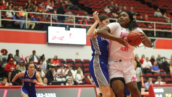Tearra Banks attempts to drive toward the basket during