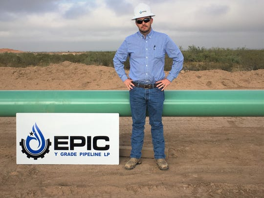 Justin Gordon, EPIC Senior VP of Engineering and Operations, stands in front of a pipeline that will  eventually move natural gas between southeastern New Mexico and Corpus Christi. A ground breaking for the project was Tuesday, Nov. 14, 2017.