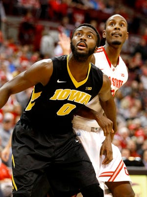 Gabe Olaseni has been a force as Iowa's sixth man this season. He and Adam Woodbury form Iowa's center tandem.