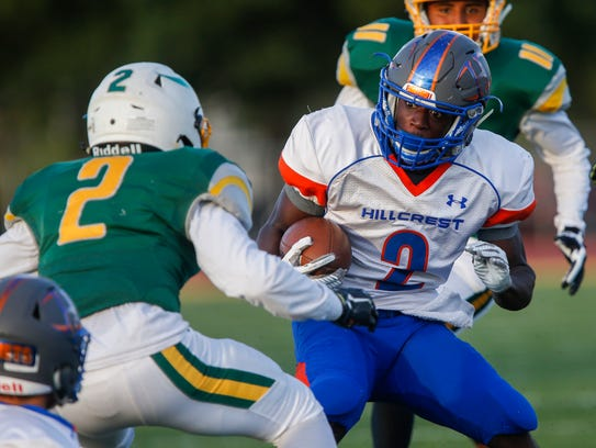 Hillcrest receiver Josh Powell puts a move on a Parkview