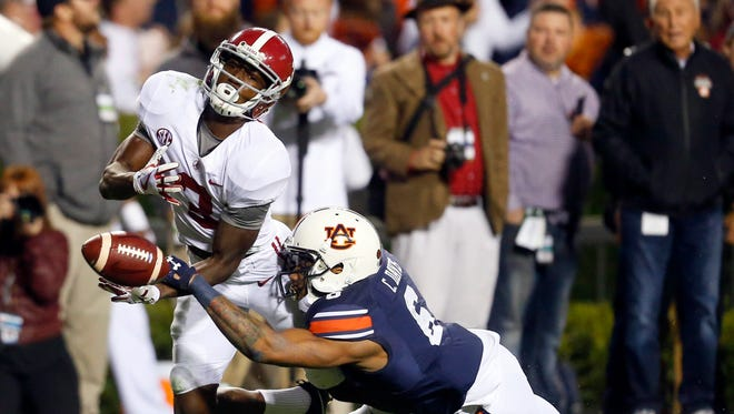 Auburn defensive back Carlton Davis breaks up a pass intended for Alabama wide receiver Calvin Ridley but is called for pass interference.