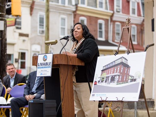 Symanthia Sheppard, wife of Harry Sheppard, makes remarks in November 2015. Demolition on the original Walt's Flavor Crisp Chicken restaurant at Vandever Avenue and North Pine Street in Wilmington began on Wednesday, where four townhomes will be built on the site.