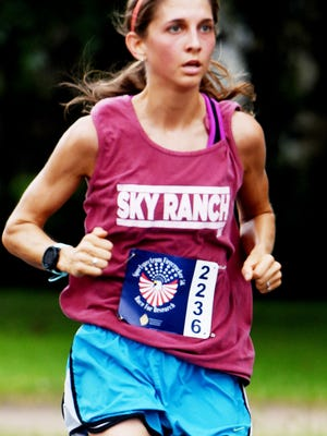 Loyola graduate Taylor Slack Dare set a personal best and captured the women's division of the 2017 Firecracker 5K Race for Research in a time of 17:42. Running helped her battle an eating disorder in high school.