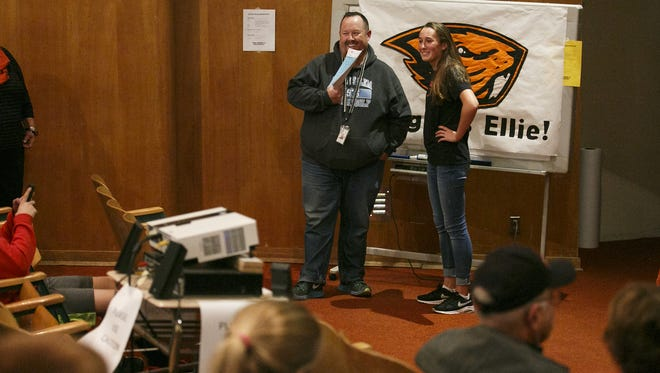 South Salem senior Ellie Slama and her coach Brian Eriksen look at the crowd joining Slama for a signing ceremony on Wednesday, Nov. 9, 2016. Slama, who has won numerous golf titles and was named the 2016 Oregon Junior Golf Play of the Year, committed to playing golf for Oregon State University.