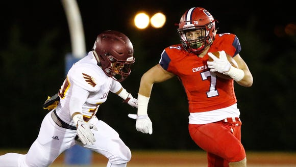 Stepinac's Antonio Giannico (7) breaks a tackle during