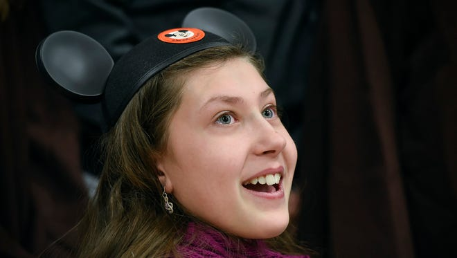 Sophie Lathe, 11, has her wish to go to Disney World granted by Make-A-Wish during a pep rally Friday, Jan. 26, at the Sartell Middle School. Students and faculty raised the money for the trip.
