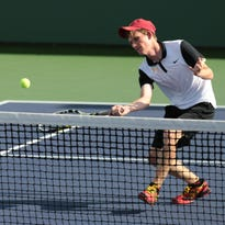 Palm Desert's Ryan Marker returns the ball to Connor Rapp also of Palm Desert High during the DVL tennis final played at the Indian Wells Tennis Garden on Tuesday. Marker won the title 6-2, 6-1.