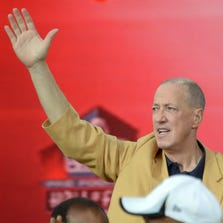 Aug 2, 2014; Canton, OH, USA; Jim Kelly waves to the crowd at the 2014 Pro Football Hall of Fame Enshrinement at Fawcett Stadium. Mandatory Credit: Kirby Lee-USA TODAY Sports