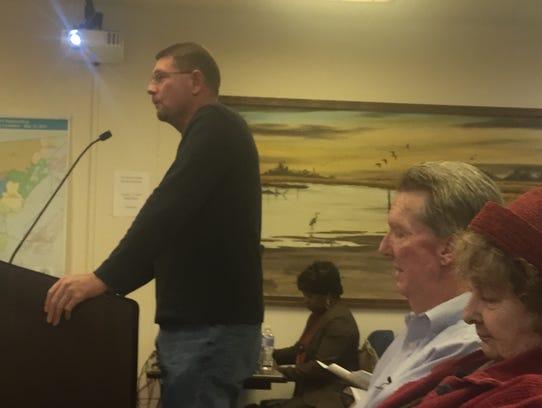 Poultry farmer Davis Lovell speaks during the Accomack