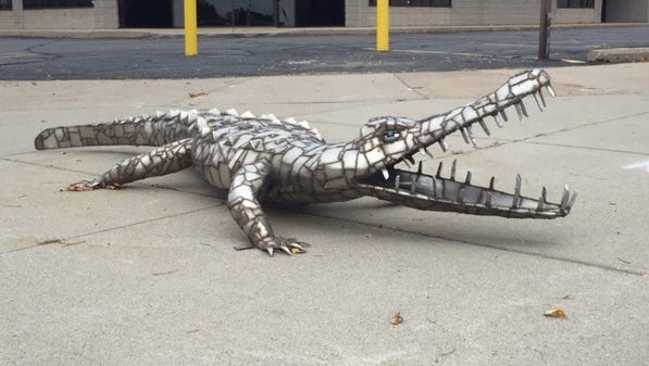 A crocodile statue on display in downtown St. Cloud was reported stolen on July 21.