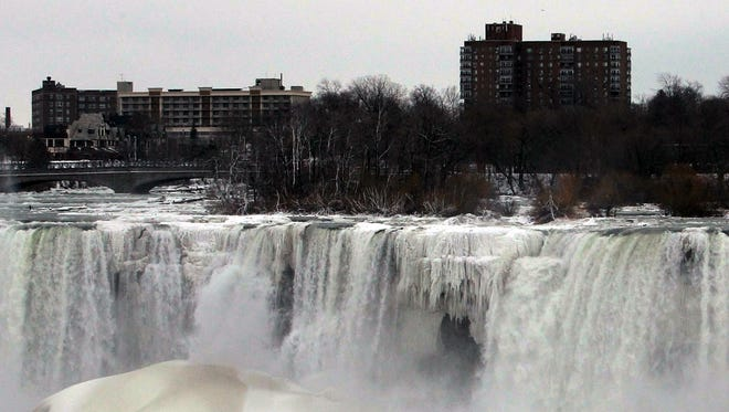 """In this Jan. 11, 2014 photo, the United States side of Niagara Falls in New York has begun to thaw after the recent """"polar vortex"""" that affected millions, driving up gas prices"""