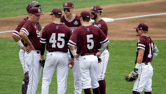 Mississippi State coach Gary Henderson, left, talks to pitcher Jacob Billingsley (45) during a visit to the mound in the first inning of an NCAA College World Series baseball game against Oregon State in Omaha, Neb., Friday, June 22, 2018. (AP Photo/Nati Harnik)