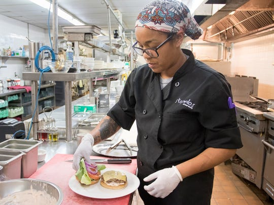 Takara Smith, chef de cuisine at Skopelos, plates an Impossible Burger on Friday, Feb. 9, 2018. The Impossible Burger, a meatless burger that bleeds, is targeted at meat eaters.
