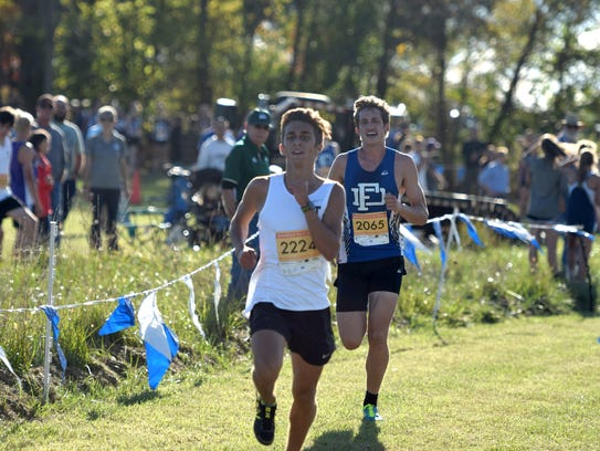 Fort Defiance's Jacob Jones, right, keeps up with Turner