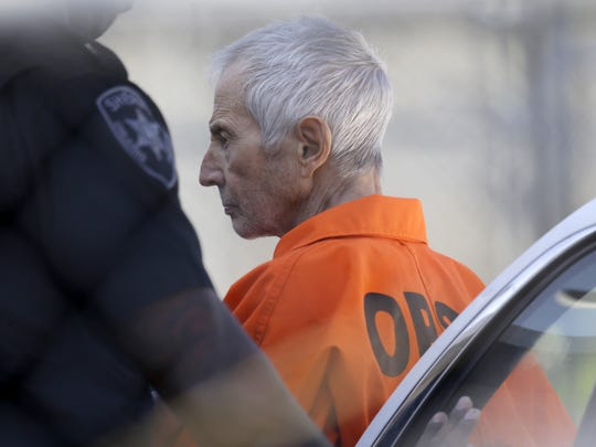 Robert Durst is escorted into Orleans Parish Prison