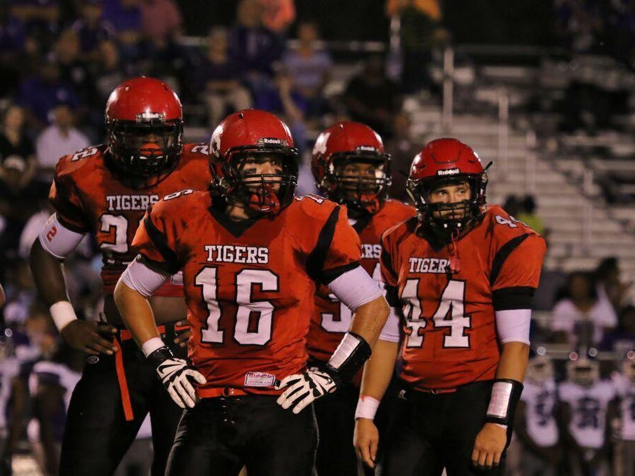 Lexington's players get together before a play in their win Friday over Haywood.