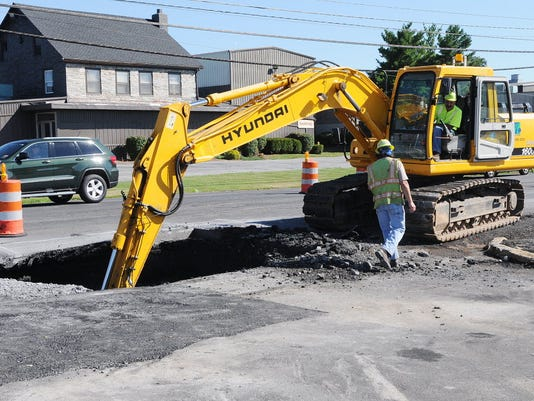 PennDOT works on a sinkhole in front of the Sinkhole Saloon on Route 422 in North Londonderry Township in this photo from last March.