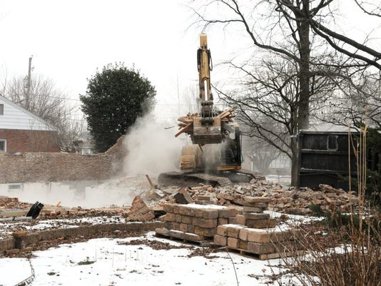 In this photo taken in February, an excavator cleans up after the demolition of the home of Joanne Grimm at the intersection of Pajabon Drive and South Lingle Avenue in North Londonderry Township. The house had to be torn down because of structural damage caused by sinkholes that spread from a nearby retention pond. A neighborhood group has asked the Lebanon County Commissioners for help to fix the pond and the sinkholes before more houses become unlivable.