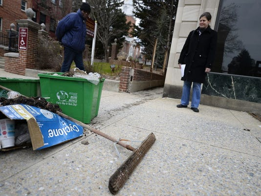 Teresa Johnescu and Ed Williams with the Olde Towne East neighborhood association talk about trash piling up on the curb of East King Street in York Wednesday, March 25, 2015.