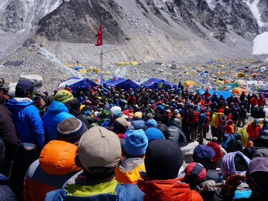 Climbers and guides gather at base camp near Mt. Everest, where an ice fall killed 16 Nepali guides and closed the climbing season.