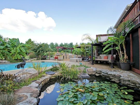 Next to the 27,000-gallon swimming pool is a 2,000-gallon koi pond with a waterfall.