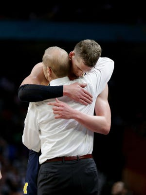 U-M coach John Beilein hugs Moritz Wagner in the final seconds of the 79-62 loss to Villanova in the national championship game Monday in San Antonio.