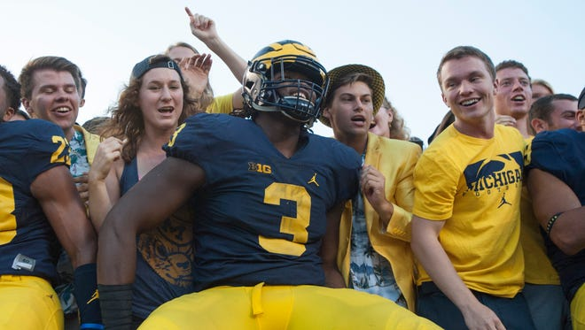 Michigan freshman defensive end Rashan Gary (3) savors the Wolverines' 45-28 victory with fans in the student section after the game.