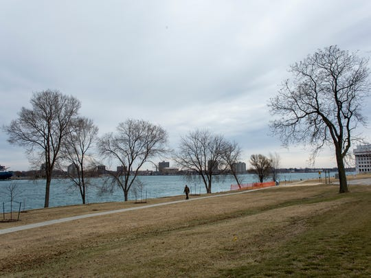A man walks along a walkway near a vacant lot where the Water's Edge Condominium development is proposed Tuesday, Feb. 2, 2016 in Port Huron. The development would include 62 units in the area bordered by Beers Street, Michigan Street and Glenwood Avenue. The walkway area would remain a public right-of-way.