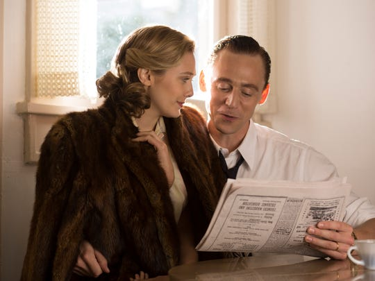 Elizabeth Olsen and Tom Hiddleston as Hank and Audrey