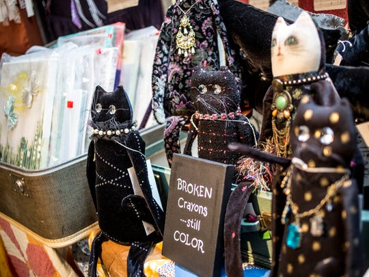 Handmade kitten dolls by artist Salli Jones of Port Huron are positioned among other art pieces during the St. Clair Art Fair Saturday, June 25, 2016, in St. Clair.