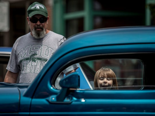 Darryl LaForest, of Port Huron, looks at 1935 Dodge Desoto with his granddaughter, Inara Closs, 5, during the Mainstreet Memories Car Show Saturday, July 30, 2016 on Huron Avenue in downtown Port Huron.
