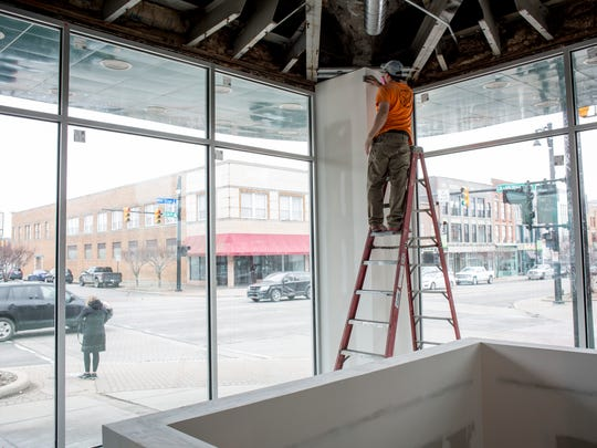 Contractor Ryan Kindred, of JFS Construction in Port Huron, sands drywall as an area is prepared for painting Friday, Feb. 24, 2017 at Sperry's Moviehouse in Port Huron. A gift shop is being constructed in the front entrance facing Huron Avenue.