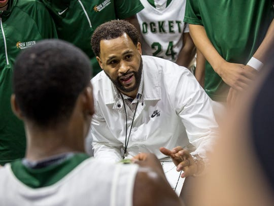 New Haven coach Tedaro France II talks with players