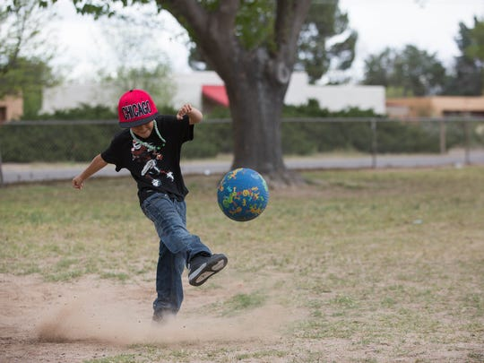 Marcos Castillo, 7, a member of the Mesilla Elementary Run Club, kicks a kickball during practice on Wednesday, March 29, 2017.