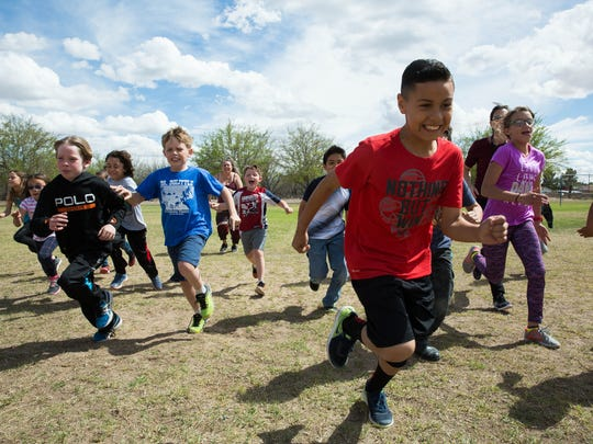 Members of the Mesilla Elementary School Run Club sprint during warm ups on Wednesday, March 29, 2017.