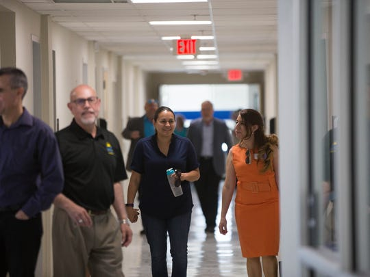 Visitors walk through the halls of  the newly opened Cervantes Complex Central Medical Center, Friday, May 5, 2017 after a ribbon cutting for the building was held.