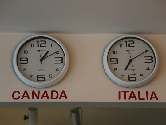 Clocks display the local time and Italian time at the Pasta House in Windsor's Little Italy.