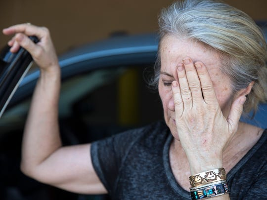 Heather Burch, who runs Brigid's Crossing Foundation cat shelter, pauses with exasperation after loading her van with 26 24-pound bags of dry cat food and 26 cases of wet cat food at Sam's Club in North Naples on Tuesday, Sept. 5, 2017. On Monday, Florida Gov. Rick Scott issued a state of emergency for Florida.