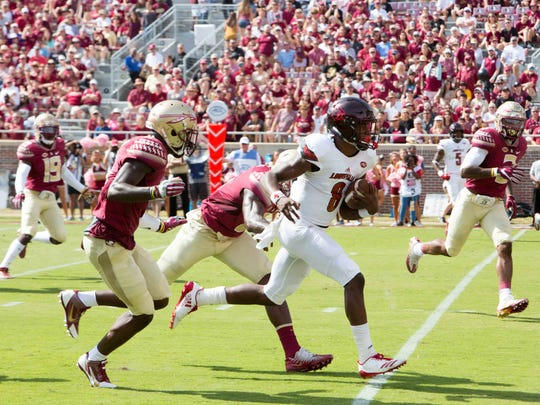 Florida State's defense struggled to slow down Louisville quarterback Lamar Jackson (8), who tallied 334 total yards and two touchdowns during the Cardinals 31-28 victory.