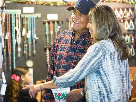 Charlie Singh and Liz Gamboa shop at the Great Spirit Creations booth on Saturday, Nov. 18, 2017, during the 4th annual HomeGrown event at The New Mexico Farm & Ranch Heritage Museum.
